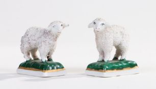 Pair of porcelain miniature sheep, Chelsea type gold anchor mark to base, each 5cm long (2)