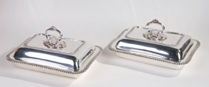 Pair of silver plated entree dishes and covers, by Mappin & Webb, each with lift up lids and