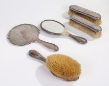 George V silver hand mirror, Birmingham 1927, together with a pair of similar brushes, London