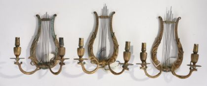 Set of three Regency style brass twin branch wall lights, of U shaped form and beast light branches,