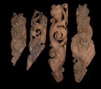 Four 18th Century Indian carved corbel brackets, the four pieces carved with scrolls and fish,