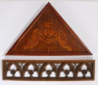 Two oak panels, to include a Gothic example with flowers to each arch, 63cm long, the second example