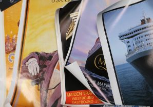 Seven cruise related posters to include Titanic, the Cunard Line, Cunard USA/Canada, two Queen