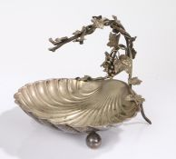 Silver plated dish, the fruiting vine cast handle above a scalloped shell form bowl, raised on