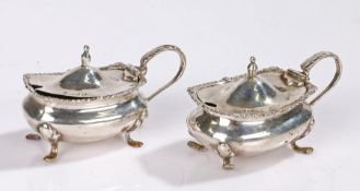Pair of Continental silver mustard pots and covers, with acanthus leaf capped handles and