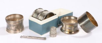 Silver, various dates and makers, to include five napkin rings, sliding cigar piercer, thimble, 2.