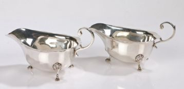 Pair of George VI silver sauceboats, Birmingham 1939, maker Asprey & Co Ltd, with double scroll