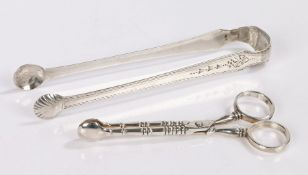 Pair of Irish silver sugar tongs, marks rubbed, with shell form terminals and harebell decorated