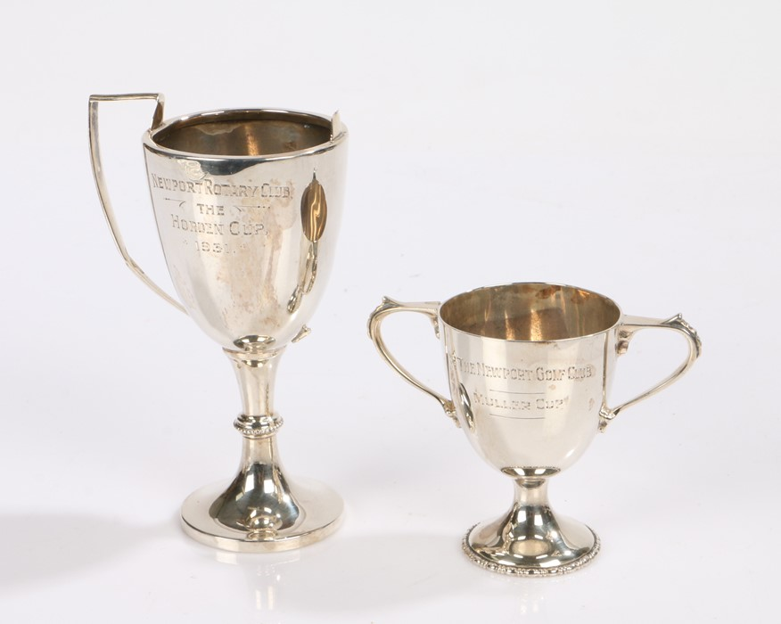 Two silver trophy cups, one with handle missing, 2.7oz