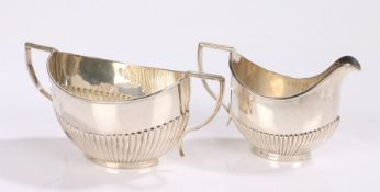 Edward VII silver milk jug and sugar bowl, Birmingham 1901, makers marks rubbed, with gadrooned