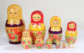 Graduating set of Russian Babushka dolls, with typical painted decoration, the tallest 24cm