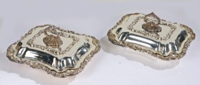Pair of J & Co silver plated entree dishes and covers, the detachable handles above foliate, shell