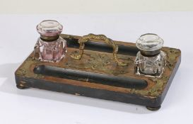 Victorian walnut desk stand, having twin glass inkwells either side of a gilt ormolu carrying handle