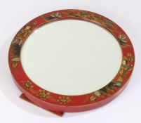 Chinese chinoiserie easel mirror, or circular form, decorated with figures and buildings on a red