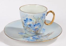 KPM porcelain coffee cup and saucer, hand painted with blue flowers and having gilt handle (2)