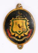 George III copper carriage plate, painted with a coat of arms of two birds within a gilt shield
