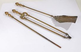 Brass three piece companion set, consisting of shovel, tongs and poker, the shovel with gadrooned
