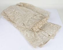 Large lace table cloth, with figural border, approx. 240cm wide x 227cm long