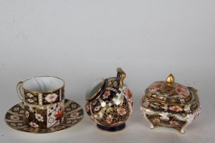 Royal Crown Derby imari pattern coffee cup and saucer, sugar bowl and pot with cover (3)