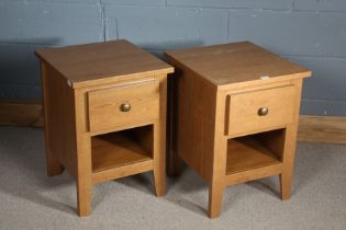 Pair of oak bedside cabinets, the rectangular top above a single drawer, raised on square tapering