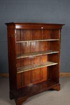 Edwardian mahogany bookcase, the moulded cornice above three adjustable shelves, raised on bracket