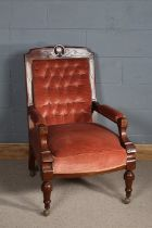 Late Victorian open armed arm chair with a shell motif to the top, upholstered in pink fabric and
