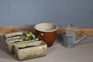 Three concrete planters of rectangular form, decorated with shell like pattern, together with a