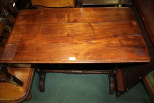 Late Victorian stretcher table, the oblong top raised on turned legs and united by a single