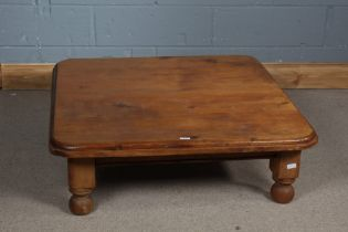Pine low table, square top above bun feet, 98cm wide