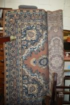 Middle Eastern style rug, the brown ground with blue floral design and multiple borders, 191cm x