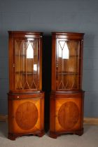 Pair of mahogany effect corner cupboards with glazed doors, above one draw, 182cm tall