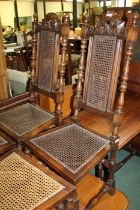 William and Mary style high back dining chairs, with pierced cane paneled back and seat (4)