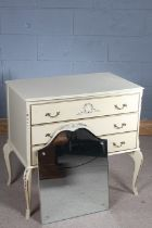 Painted dressing table, the mirror back above the serpentine top and three drawers, raised on