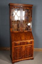 Mahogany effect bureau bookcase with two glazed doors above the fall, one draw and cupboard to the