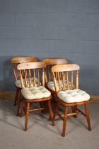 set of Four spindle chairs, with dished seats above turned legs