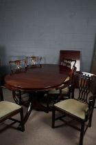 Mahogany twin pillar dining table, raised on claw feet, together with four Sheraton style dining