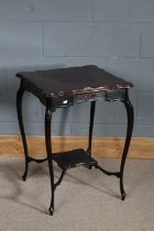 Edwardian mahogany centre table, the square top above a fret carved frieze and under tier, raised on