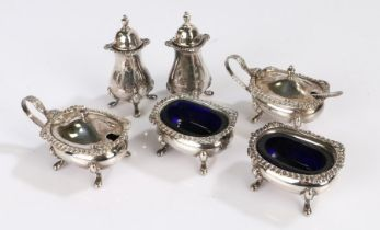 Silver plated condiment set, consisting of two salts with blue glass liners, two pepperettes and two