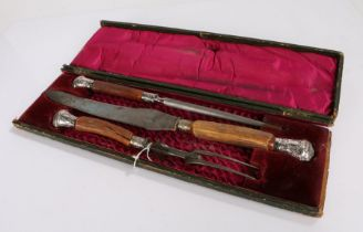 Antler handled carving set, consisting of steel, carving knife and fork, with scroll and acanthus