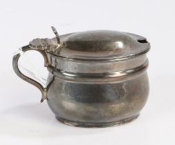 Victorian silver mustard pot, London 1897, maker Henry Stratford, the domed cover with scroll
