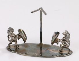 Silver plated stand, the central stem with V form terminal, flanked by two rearing lions each