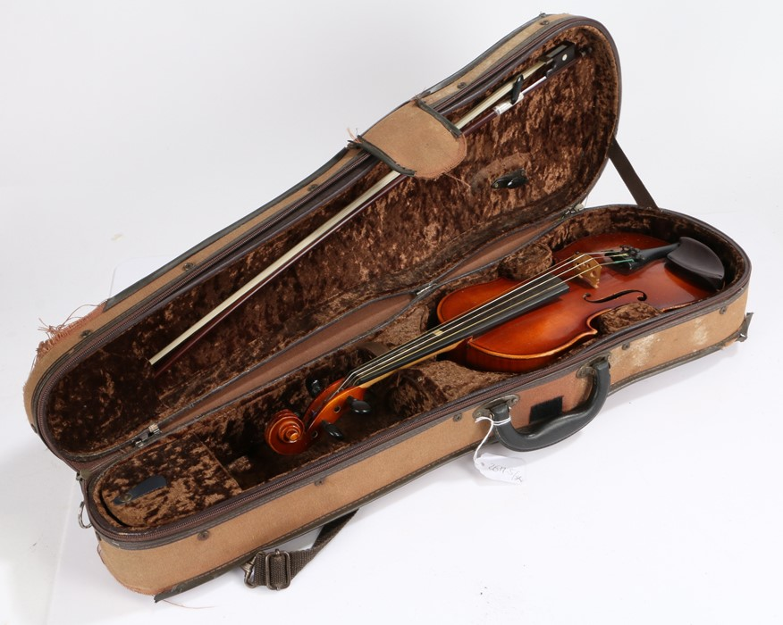 Mahogany violin with bow, two-piece back, with a label to the interior, made in W.-Germany, 52cm