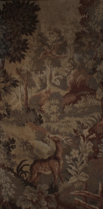 19th Century wool work panel, with a deer among trees and foliage, 75cm x 141cm