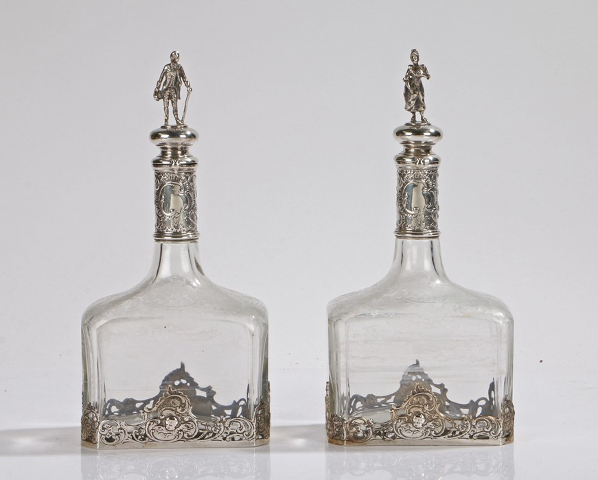 Pair of continental silver mounted bottles, the figural finials in the form of a lady and