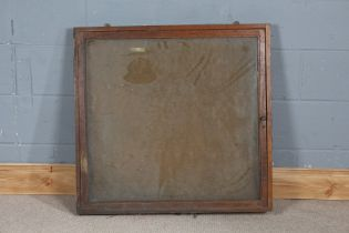 Early 20th century oak and glazed notice board, with hinged door (AF), 84cm wide x 80cm high