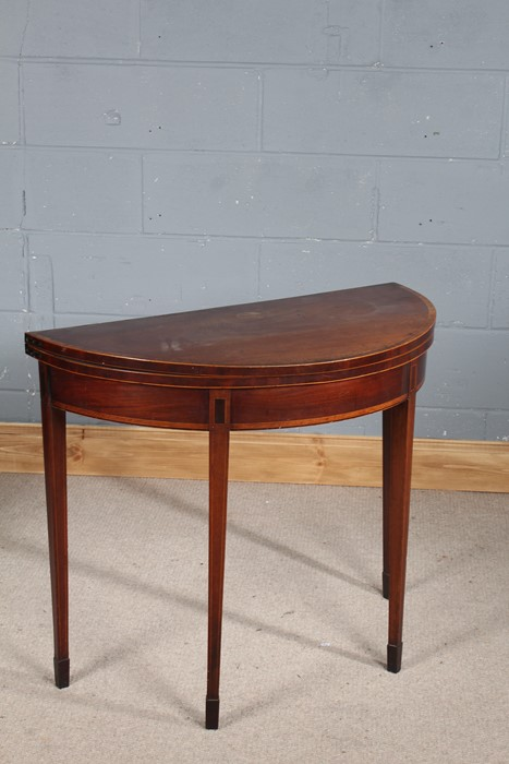 George III mahogany and boxwood demi-lune card table, the hinged top have crossbanded boxwood