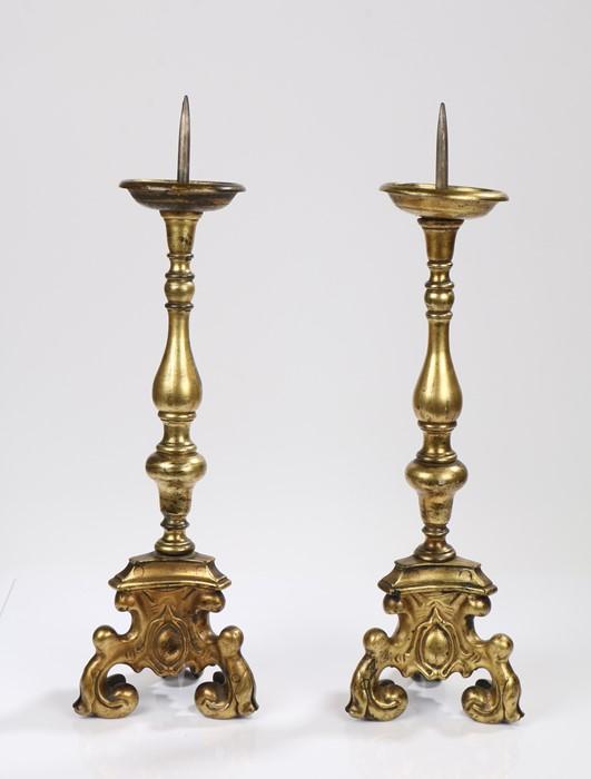 Pair 18th Century gilt bronze pricket altar sticks, with knobbed stems and trefoil scroll legs, 60cm