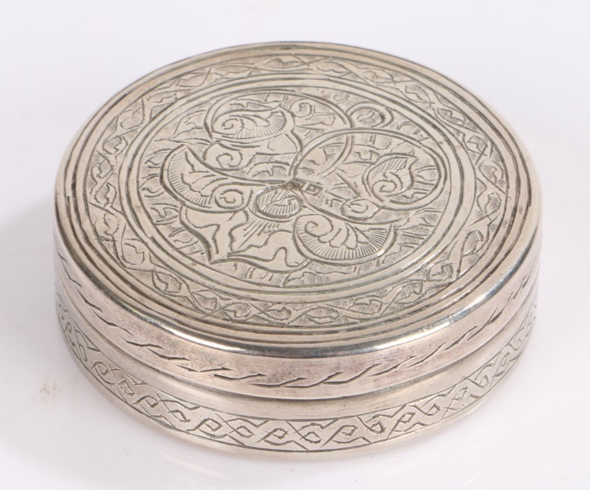 Egyptian silver circular pot and cover, the lid with scroll decoration, 5.5cm diameter, 1.5oz