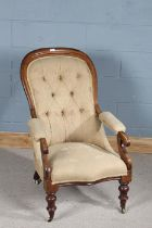 Victorian mahogany button back armchair, having open scroll armrests and turned knopped legs,