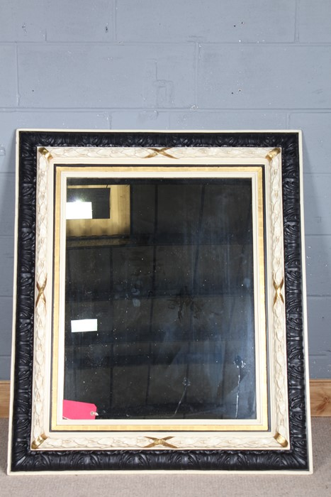 Ebonised, cream painted and gilded rectangular wall mirror, foliate carved outer, leaf and berry